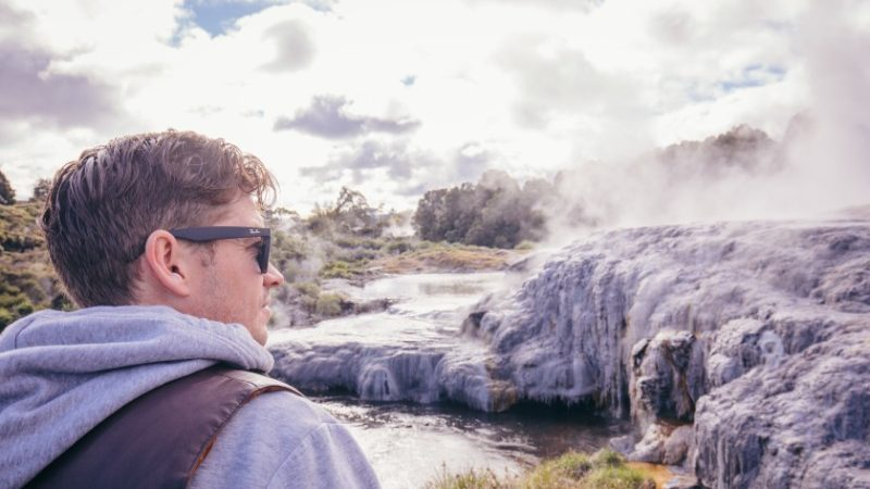 Traveller observing volcanic activity in New Zealand