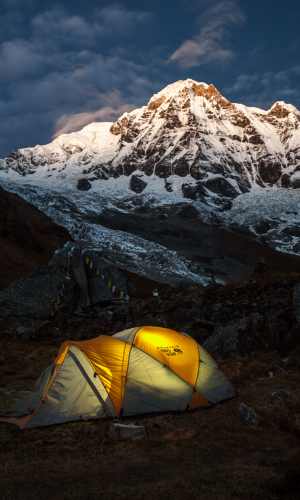 A tent and Annapurna South at sunrise as taken from Annapurna Base Camp