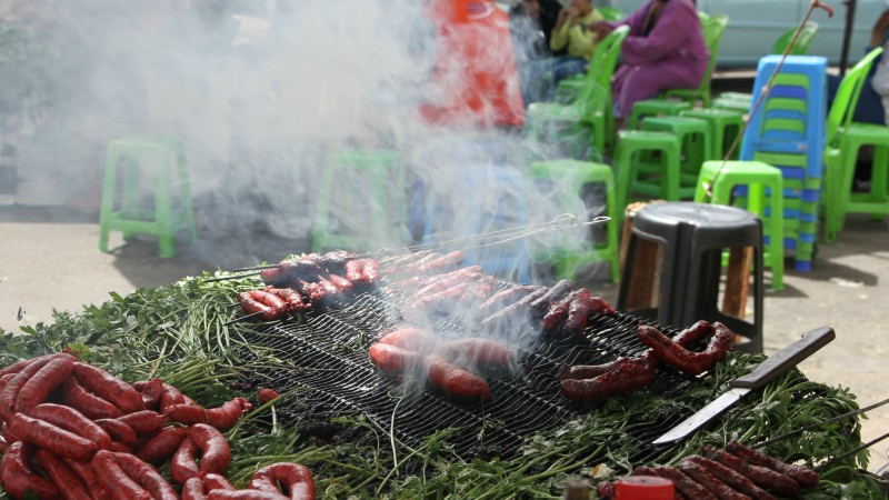 Merguez cooking in an open-air market in Meknes