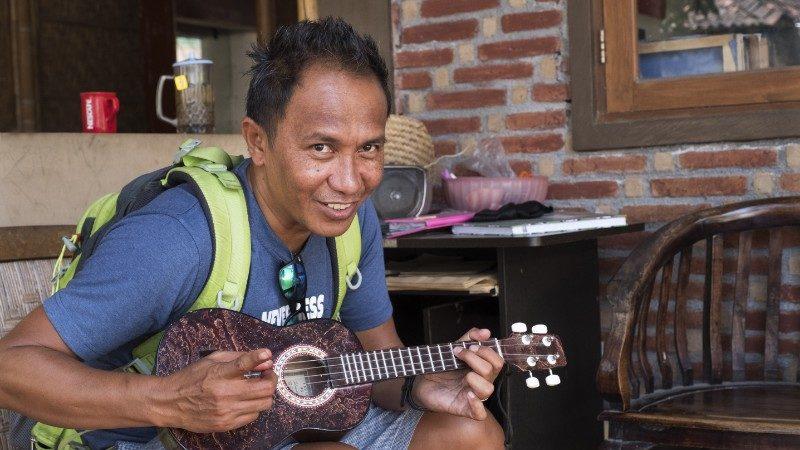 Tour leader playing ukelele