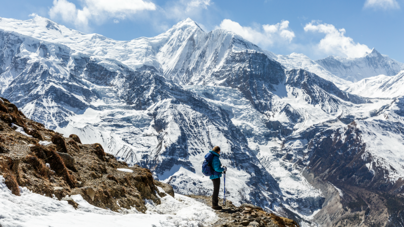 A hiker in front of Annapurna II, on the Annapurna Circuit Trek