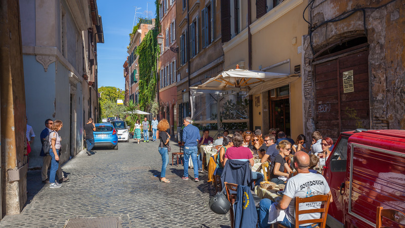 Diners at an outdoor restaurant in Rome