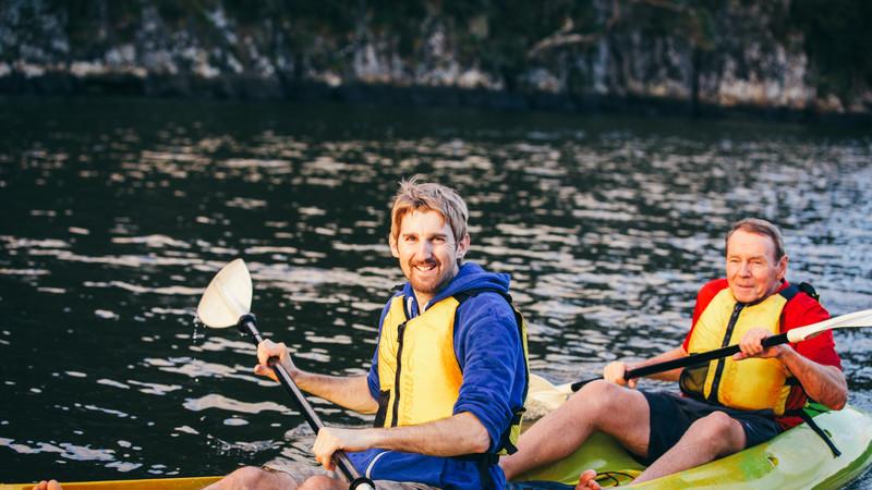 Travellers kayaking at Bay of Islands