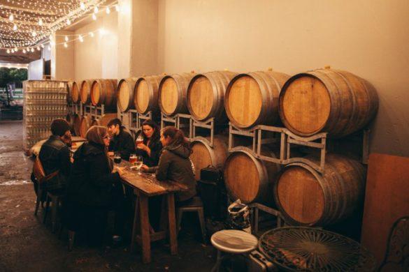 People and wine barrels in Wellington bar