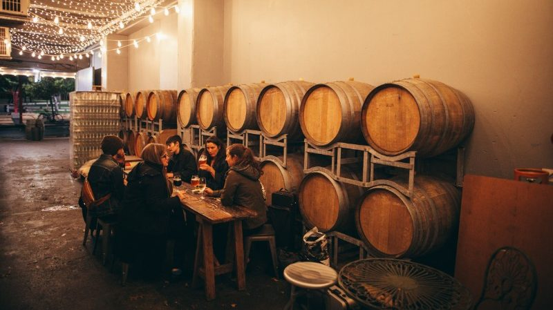 People and wine barrels in Wellington bar