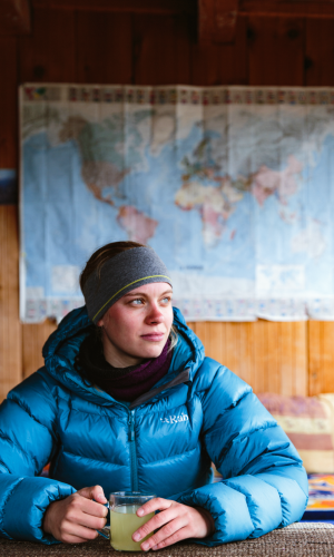Trekker in a teahouse on the Annapurna Circuit