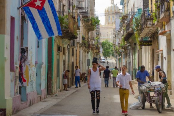 Havana street with Cuban flag.