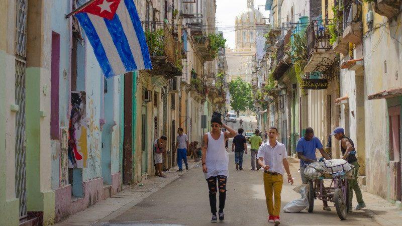 Havana street with Cuban flag.