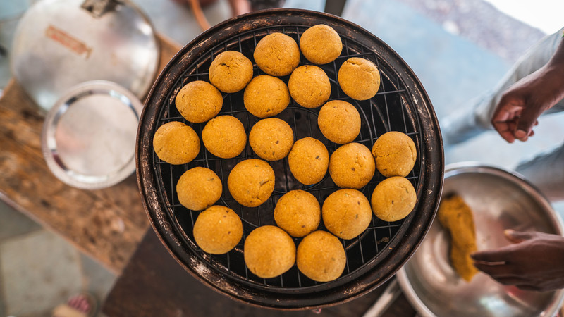 Grill covered in delicious fried Indian food