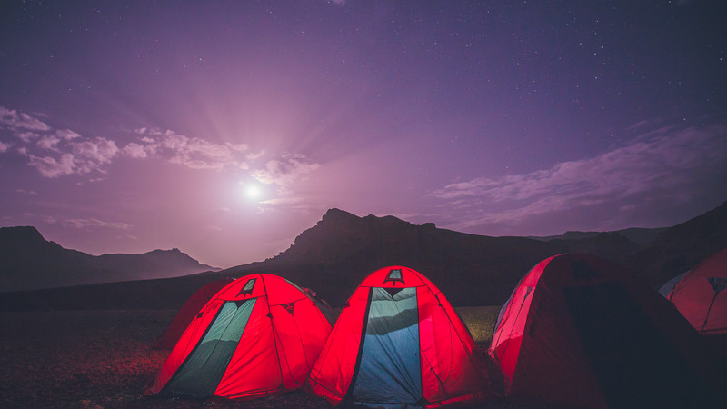 Tents pitched in the moonlight