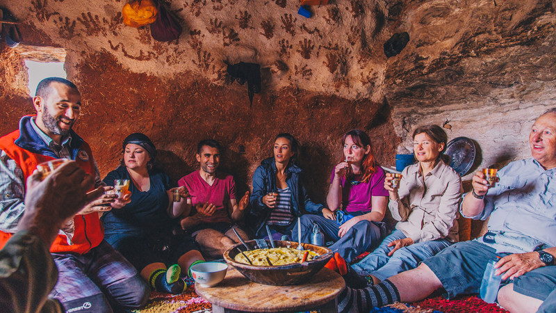 Travellers eat lunch in a cave