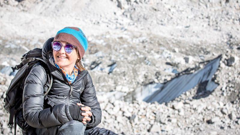 Trekker sitting down in snow