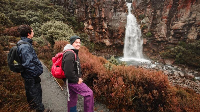 Travellers admiring Taranaki Falls