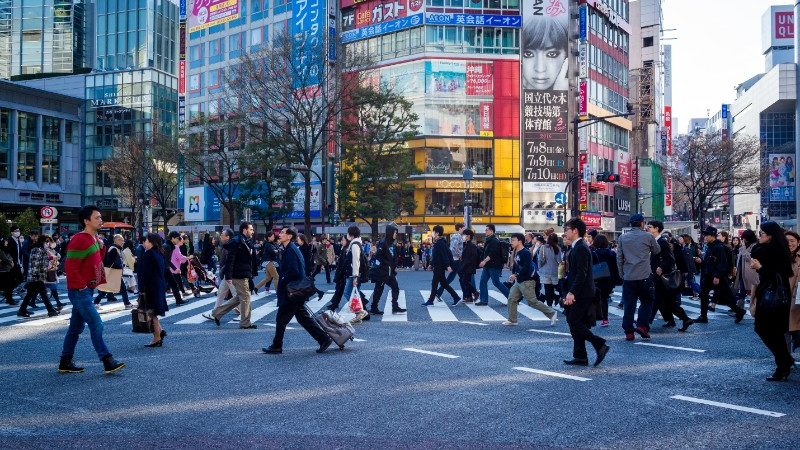 Pedestrians crossing the road in Tokyo