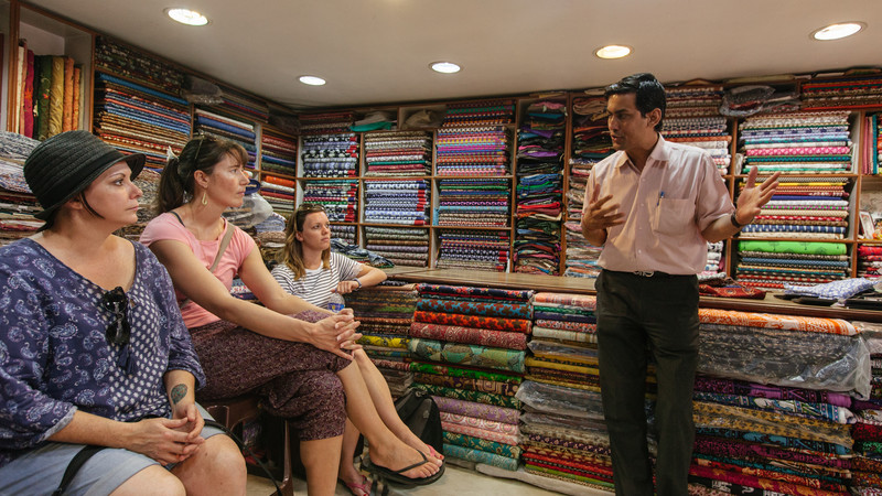Local Indian man in fabric shop