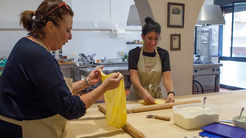 Two women making pasta