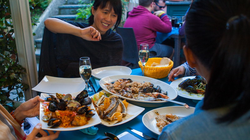 A group of women enjoying a seafood lunch