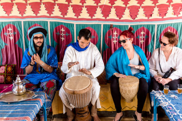 Four people playing drums in Morocco