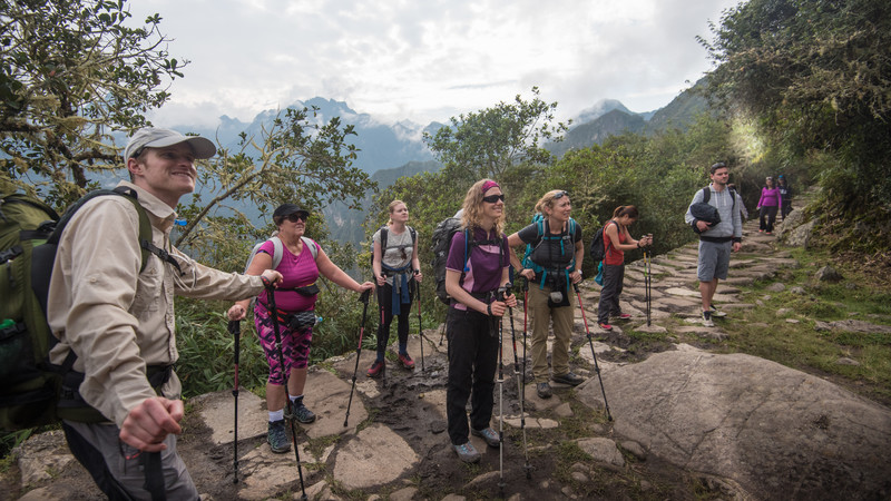 Travellers with hiking poles on the Inca Trail