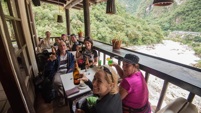 Travellers enjoying a beer after the trek