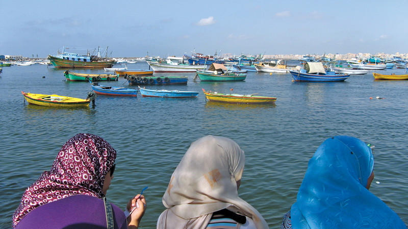 Local women looking out over the water in Alexandria, Egypt