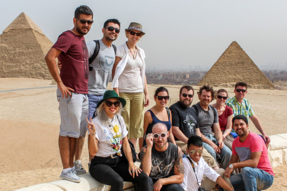 Group of travellers in front of the Pyramids, Egypt