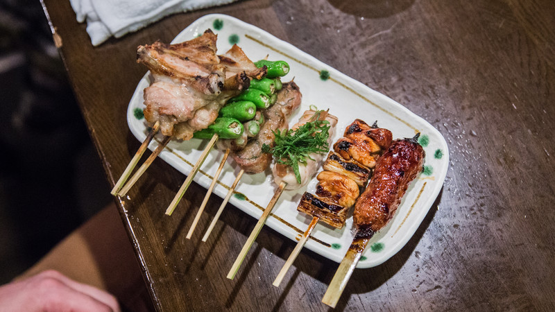 A plate of skewered food in Japan
