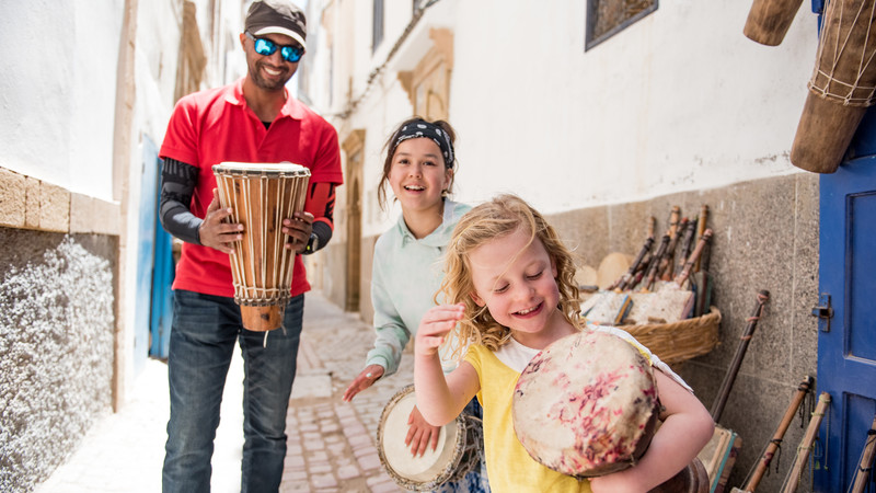 Two kids and their tour guide in Morocco