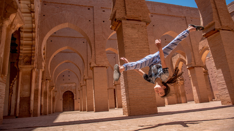 A girl does a flip in Morocco