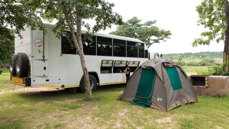 Tent pitched beside overland truck