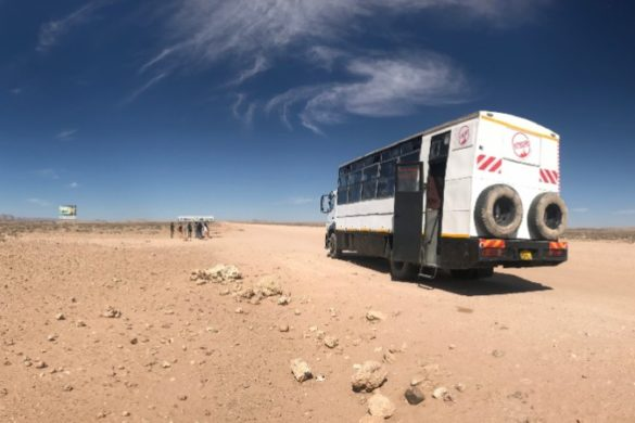 Intrepid vehicle and passengers at the Tropic of Capricorn