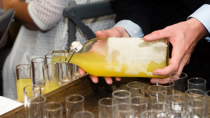 Pouring limoncello into glasses