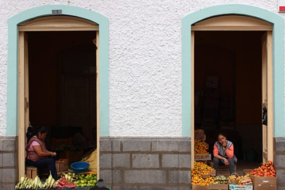Two women selling vegetables in Banos