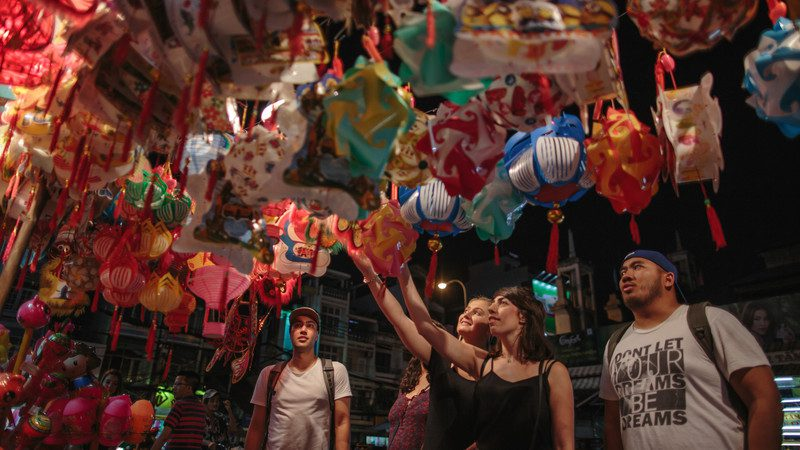 Travellers admiring coloured balloons in Vietnam