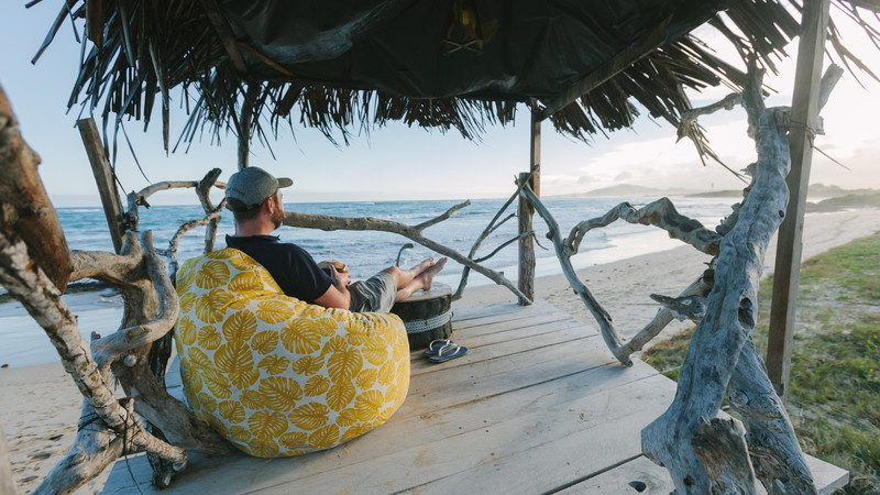 Man sits in a beach hut in Ecuador
