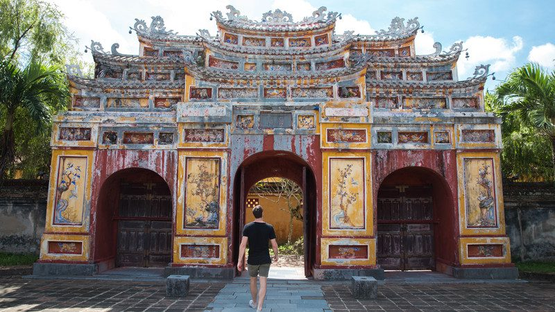 Man walking into a temple in Hue