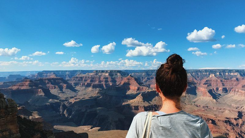 Girl looks out over the Grand Canyon