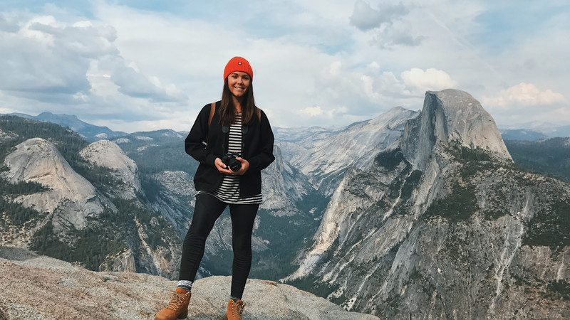 Girl stands in Yosemite National Park