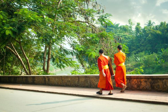 Monks walking in Laos