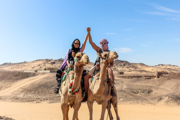 Two travellers on camels in Egypt