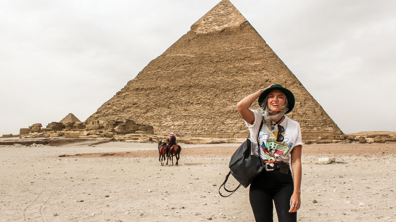 Female traveller at the pyramids
