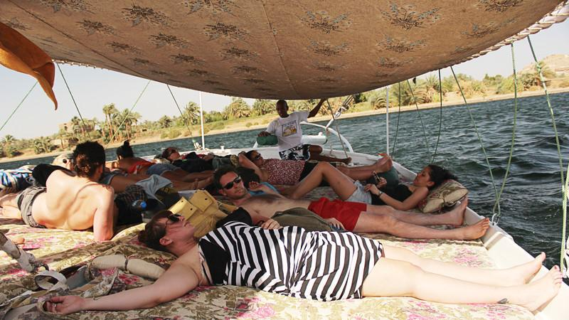 Travellers relaxing on a felucca