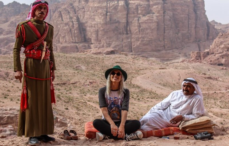 A traveller and two locals in Jordan