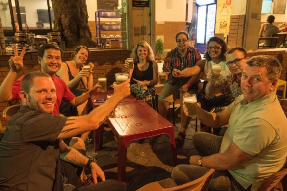 A group of travellers enjoying bia hoi in Vietnam