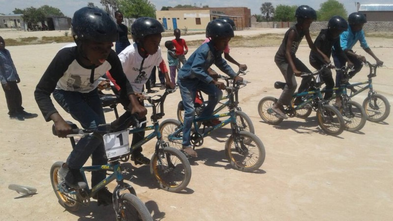 Kids racing on their bikes