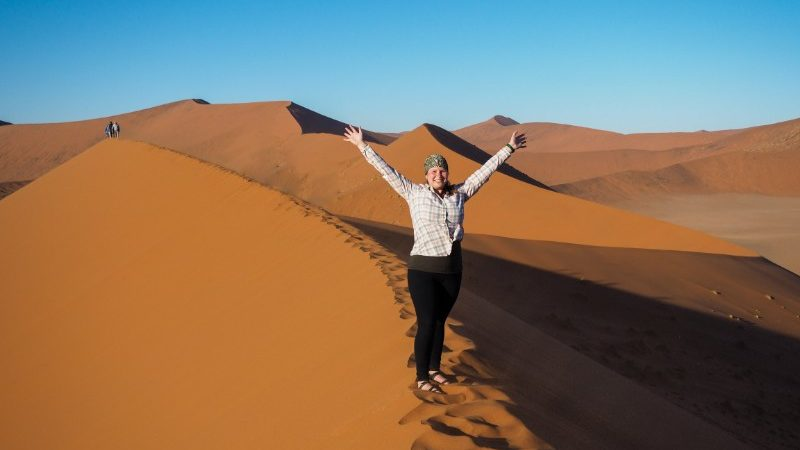 Traveller on a sand dune in Namibia