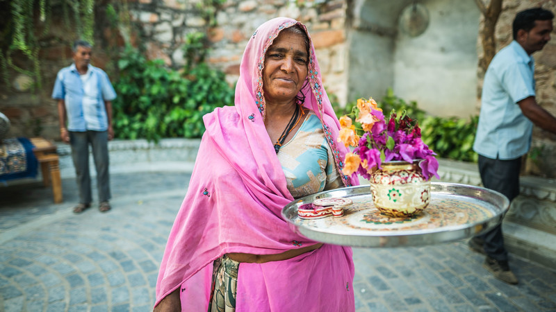 A woman holding flowers in India