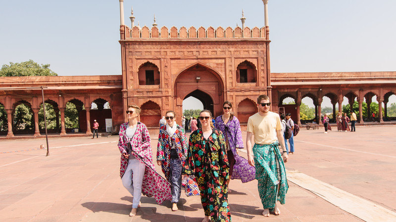 Travellers at Jama Masjid mosque in India