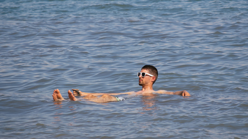 A man floats on the Dead Sea