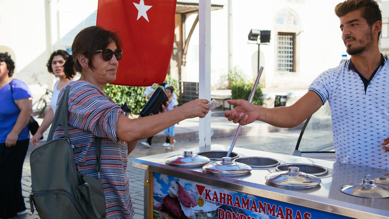 A hungry traveller buying a Turkish ice cream in Antalya